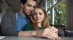 Young couple students lovers kissing playing Hands and Fingers at cafe table Stock Footage