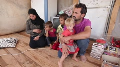 October 22, 2016: family in room, father speak, ISIS war, Syria Stock Footage