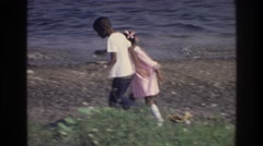 1976: kids playing on a rocky beach HARLEM NEW YORK Stock Footage