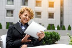 Smart businesswoman entertaining with modern technology Stock Photos