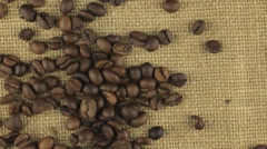 Falling coffee beans on a rotating cloth burlap Stock Footage