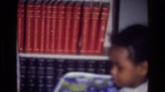 1976: little girl crying beside her stroller in the front room. HARLEM NEW YORK Stock Footage