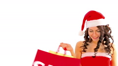 Woman in Santa hat holding shopping bag. Isolated. Stock Footage