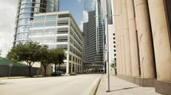 Wide street view of highrise office buildings in downtown houston 4k Stock Footage