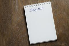 Things to do list on notepad on wood table Stock Photos