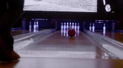 Bowling at bowling alley Stock Footage