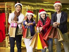 Young asian people shopping for christmas Kuvituskuvat