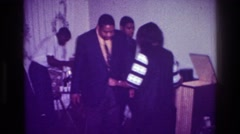 1976: man and woman dancing during a party, enjoying music and beverages HARLEM Stock Footage