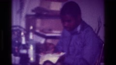 1976: middle aged african-american man taking a break from work to enjoy a home Stock Footage