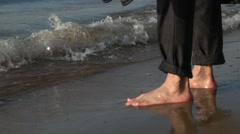 Businessman goes barefoot on the water Stock Footage