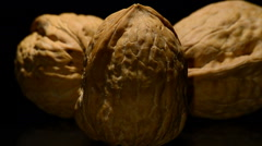Walnuts in rotation on black background Stock Footage