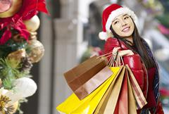 Young asian woman shopping for christmas Kuvituskuvat