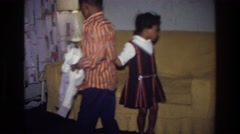 1976: little kids playing around in the living room. HARLEM NEW YORK Stock Footage