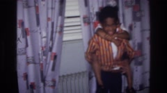 1976: brother and sister goofing off in the living room. HARLEM NEW YORK Stock Footage