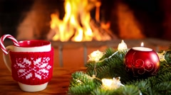 Cup of mulled wine near fireplace Stock Footage
