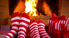Family in Christmas socks near fireplace Stock Footage