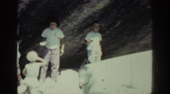 1962: beautiful children standing and playing under a large rock RHODES GREECE Stock Footage