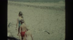 1962: several children walking in a holiday area on a sunny day RHODES GREECE Stock Footage