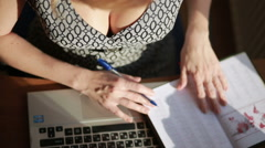 Busty sexy business woman working for a laptop. top view Stock Footage