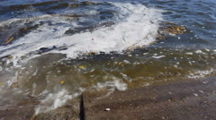 Environmental problems. Garbage floating on water. Stock Footage
