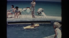 1962: people swimming at a public pool on a warm summer day RHODES GREECE Stock Footage