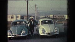 1962: man poses with two vw beetles RHODES GREECE Stock Footage