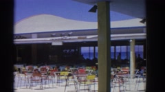 1962: stunning resort view of a hotel alongside a body of water RHODES GREECE Stock Footage