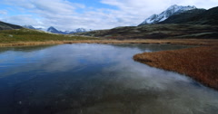 Frozen Tundra Ice Lake and Mountain Aerial 2K Stock Footage