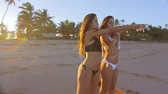 Beautiful And Attractive Brazilian Twin Sisters Beach In Slow Motion Stock Footage