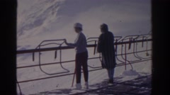 1963: two people are in a ski resort watching the snowy mountains MUNICH GERMANY Stock Footage