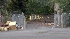 Urban keep clear sign, derelict industrial cut away Stock Footage