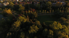Flying over city park, fall foliage Stock Footage