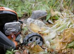 Lawn Mowing In Autumn Stock Photos