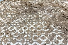 Leveling ground at new parking place by removing excess material Stock Photos