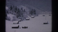 1963: snow covered area with houses and a mountain view MUNICH GERMANY Stock Footage