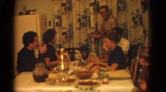 1963: family gathered around a dining table enjoying a thanksgiving feast Stock Footage