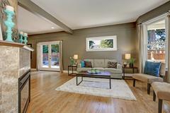 Open floor plan family room with green walls and hardwood floor. Northwest, U Stock Photos