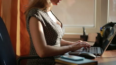 Busty sexy business woman working for a laptop. Stock Footage