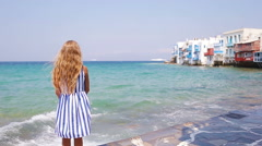Adorable little girl at Little Venice the most popular tourist area on Mykonos Stock Footage