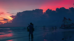 Tourists walk at sunset along the white beach of Boracay Island. 4K TimeLapse - Stock Footage