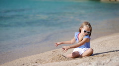 Adorable little girl on the beach during greek vacation Stock Footage