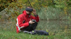 Man Watching Video 360 Degrees in vr Glasses Using Smartphone Clicks the Device Stock Footage