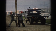 1962: men trying to put up a light pole. EPHESUS TURKEY Stock Footage