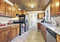 Brown wooden interior design of kitchen room. Wooden ceiling, tile floor , ca Stock Photos
