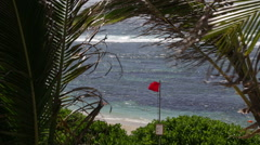 Red waving flag on a coast in Mauritius Stock Footage