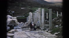 1962: two women with kids are visiting old relics of a structure EPHESUS TURKEY Stock Footage