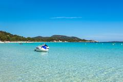Jet ski mooring in the turquoise water of  Rondinara beach in Corsica Island  Stock Photos
