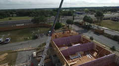 Crane laying house trusses by Drone Stock Footage