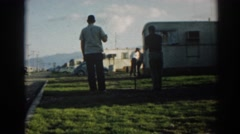 1962: men outdoor playing games in garden area EPHESUS TURKEY Stock Footage