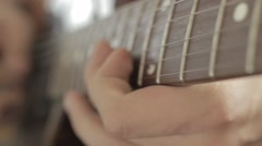 Professional Guitarist Playing Riffs On Electric Guitar At Home Studio. Close Up Stock Footage
